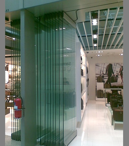 Alaform frameless glass folding door systems for Sliding glass wall systems